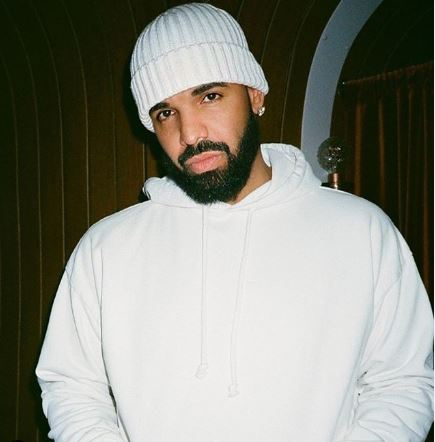 Drake wearing a white beanie with a white hoodie