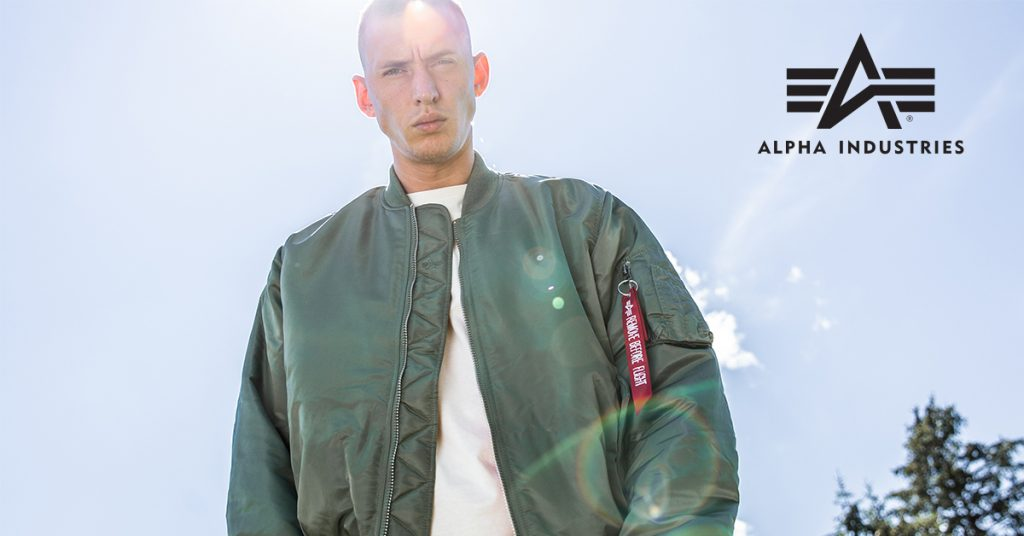 a man wearing an Alpha Industries jacket