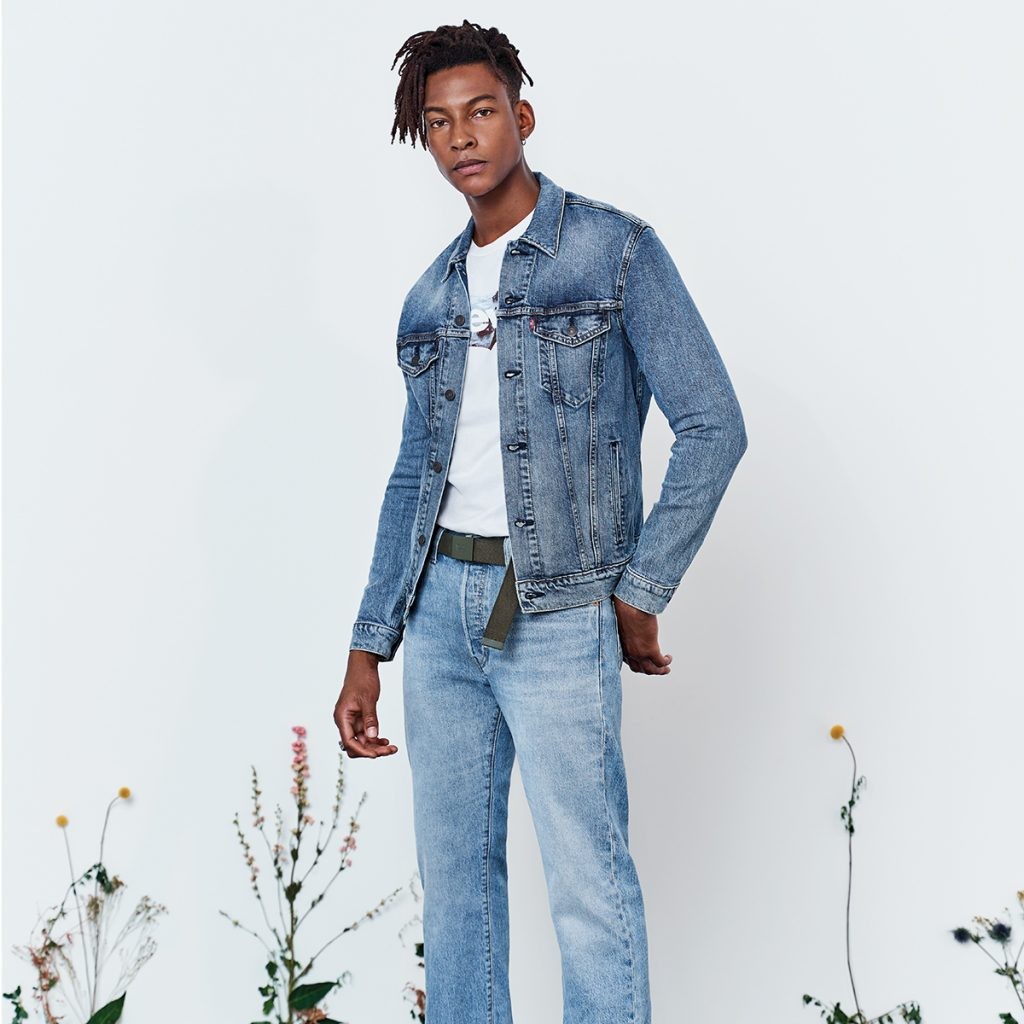 a man wearing levis denim jeans and jacket